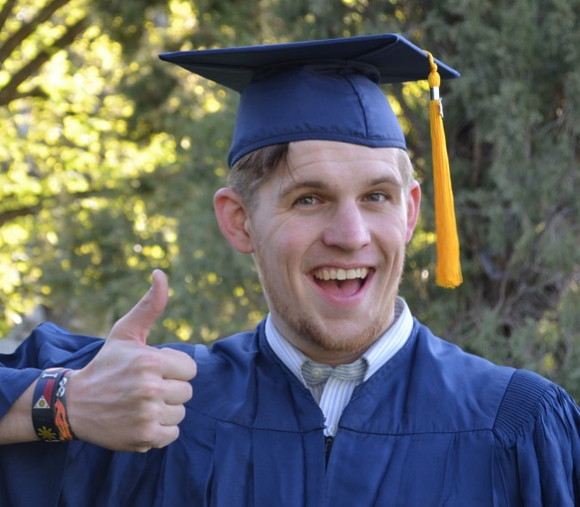 a picture of a college graduate giving a thumbs up