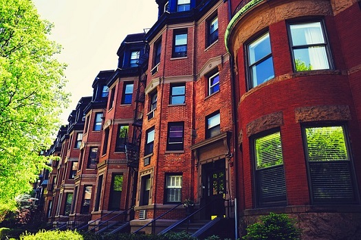 picture of a brooklyn street with a bunch of brownstones