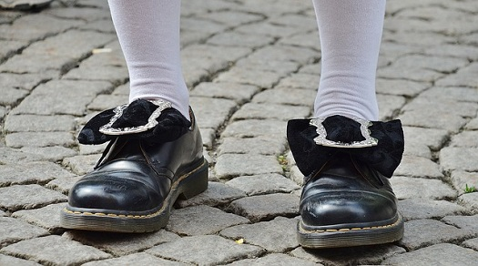 picture of a man with wearing black shoes with white socks