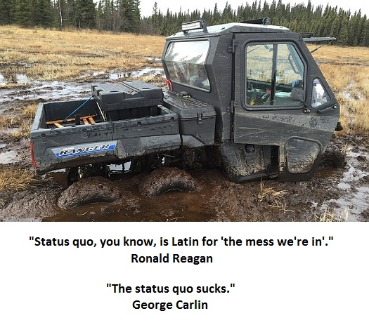 picture of a utility vehicle stuck in the mud