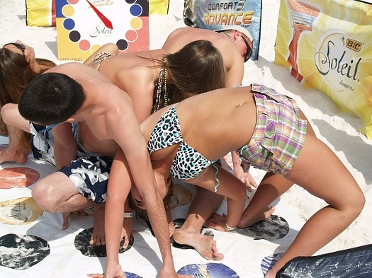 a picture of college students on spring break playing twister