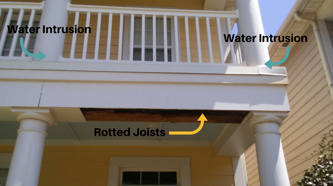 a picture of my neighbor's two story porch showing the columns where water intruded