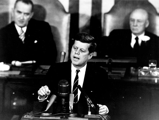 A picture of JFK addressing Congress