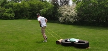 A picture of John dragging the weighted toboggan