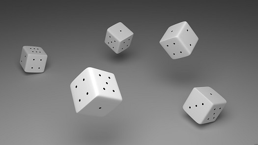 a picture of tumbling dice to symbolize luck