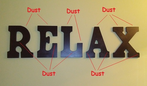 """a picture of my bathroom wall showing the """"relax"""" spelled out"""