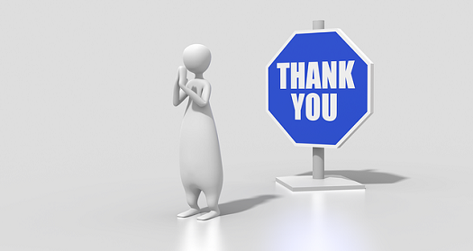 "a picture of a bubble person standing in front of an octagonal sign which reads ""thank you"""