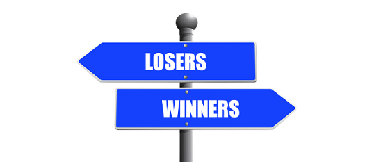 a picture of a sign post indicating the direction for losers and winners