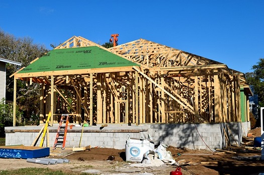 a picture of a residential home in the framing stage of construction
