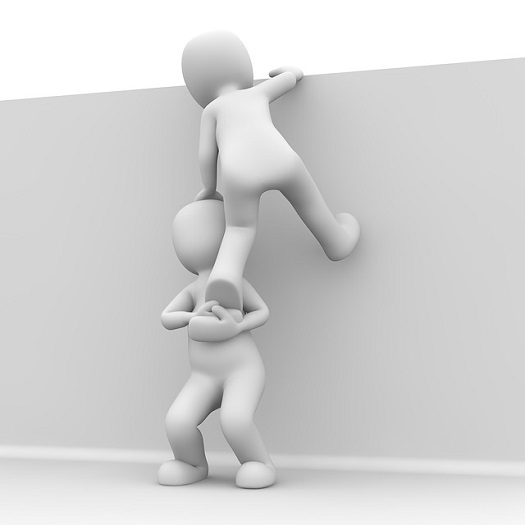 a picture of a white bubble figure helping another white bubble figure over a wall