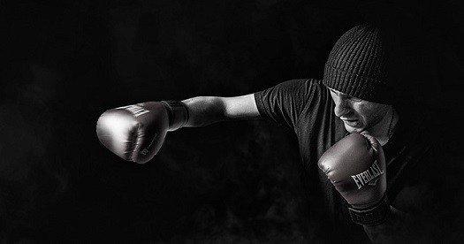 a picture of a boxer in training throwing a punch